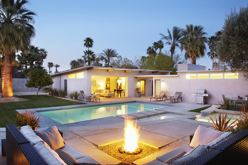 Tranquil patio area with seating, fire pit and swimming pool